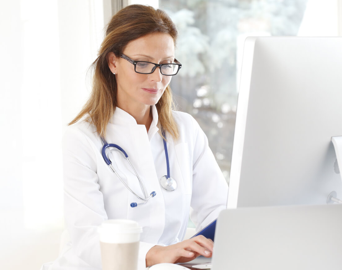 Female doctor working at a computer