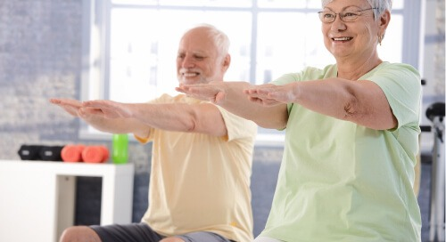 Two older people exercising