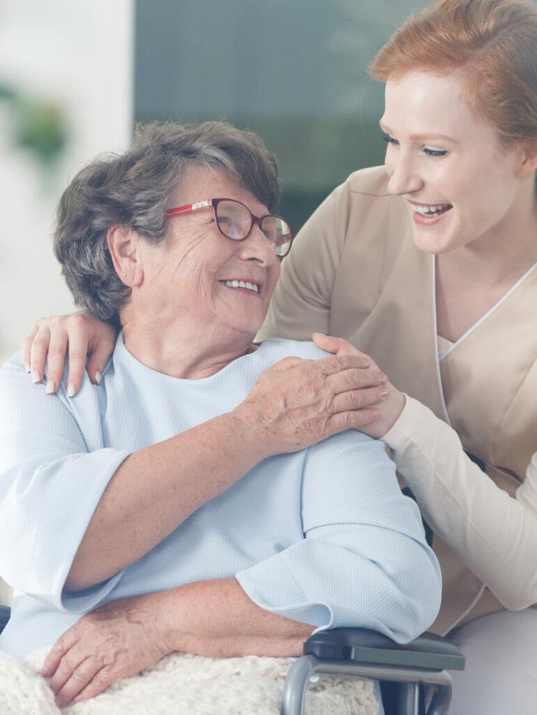 Medical volunteer smiling with her patient