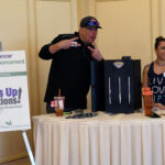 A promotional booth at the Drive Out Cancer event